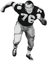 black and white picture of young Dave Rowe in football attire