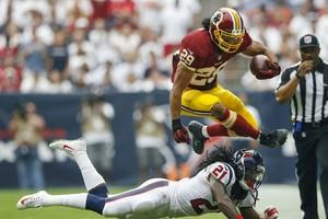 Roy Helu Jr jumping over other football player
